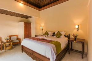 A bed or beds in a room at Jagi Villa