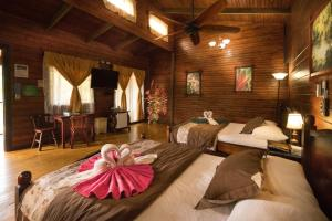 A bed or beds in a room at Blue River Resort & Hot Springs