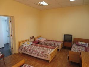 Кровать или кровати в номере Гостиница  УДПО
