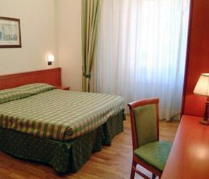 Ein Bett oder Betten in einem Zimmer der Unterkunft Hotel Picchio