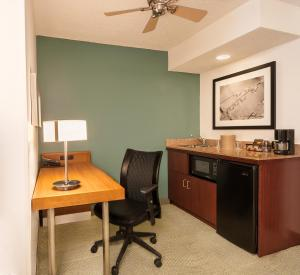 A television and/or entertainment center at SpringHill Suites by Marriott Baton Rouge South