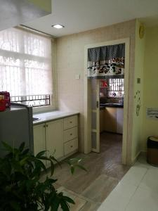 A kitchen or kitchenette at Angel's Penang Homestay