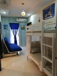 A bunk bed or bunk beds in a room at Angel's Penang Homestay