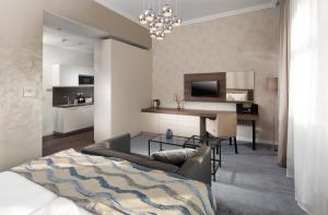A bed or beds in a room at Mamaison Residence Sulekova Bratislava