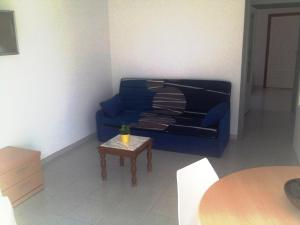 Een zitgedeelte bij Bungalow Cala Llobeta 32