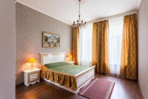 Кровать или кровати в номере Stremyannaya 7 Apartment