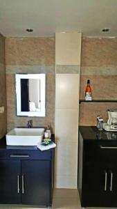 A bathroom at Hotel Graham Villahermosa
