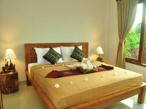 A bed or beds in a room at Angga Homestay