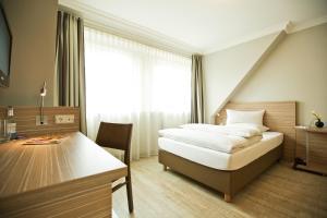 Ein Bett oder Betten in einem Zimmer der Unterkunft Boutiquehotel Myn Utspann