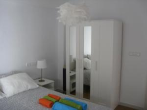 A bed or beds in a room at Unique Plaza Higuitos
