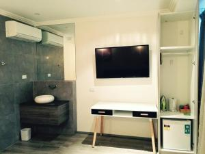 A television and/or entertainment center at Posh Hotel