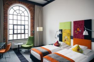 Кровать или кровати в номере Vienna House Andel's Lodz
