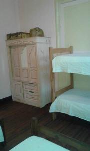 Una cama o camas cuchetas en una habitación  de Hostel La Rosa De Los Vientos