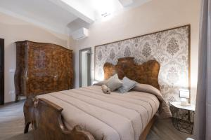 A bed or beds in a room at Accademia