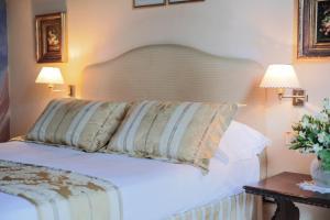 Ein Bett oder Betten in einem Zimmer der Unterkunft Hotel Villa Liana