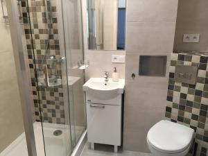 Łazienka w obiekcie Apartament Melisa