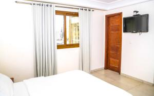 A bed or beds in a room at Manhantan Living