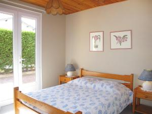 A bed or beds in a room at Holiday Home Oyan Aldo
