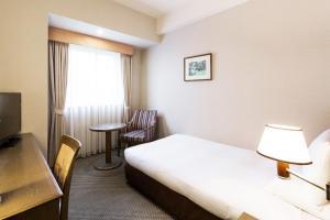 MYSTAYS 札幌 Aspen 酒店房間的床