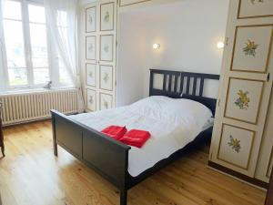 A bed or beds in a room at Apartment Le Béarnais
