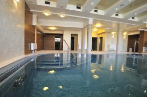The swimming pool at or near Hotel Knieja Spa&Wellness