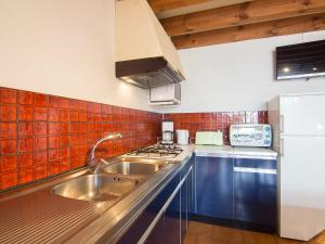 A kitchen or kitchenette at Holiday Home Sicard-6