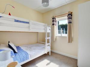 A bunk bed or bunk beds in a room at Holiday Home Eglos