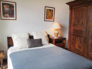 A bed or beds in a room at Holiday Home Fromental