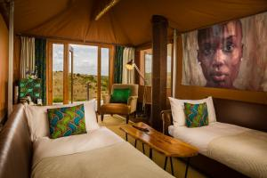A bed or beds in a room at Mahali Mzuri
