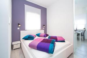 A bed or beds in a room at Apartments Aida