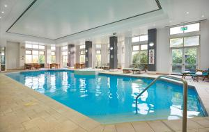 The swimming pool at or near DoubleTree by Hilton Dartford Bridge