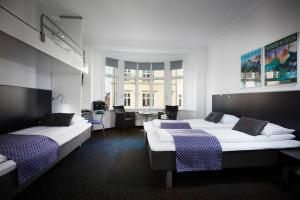 A bed or beds in a room at Cabinn Esbjerg
