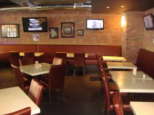Restaurant ou autre lieu de restauration dans l'établissement The Skyline Hotel New York