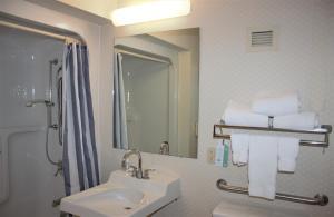 A bathroom at Ramada by Wyndham Wentzville