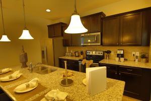 A kitchen or kitchenette at Disney Villa 6Bd/5Ba for 13 sleeps pool/spa
