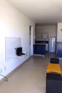 A television and/or entertainment center at Varandas da Praia Apartamentos