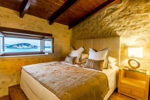 A bed or beds in a room at Exensian Villas & Suites