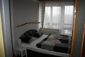 Ein Bett oder Betten in einem Zimmer der Unterkunft Pension U slunce
