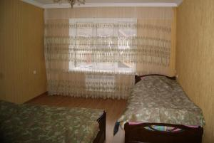 A bed or beds in a room at Apartment in Elbrus village