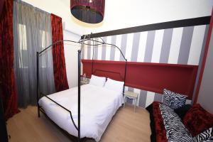 A bed or beds in a room at Heart of Florence