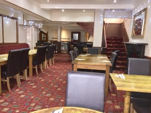 A restaurant or other place to eat at Plas Coch Hotel Ltd