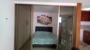 A bed or beds in a room at Apartahotel Calle del tiempo detenido