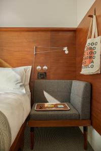A bed or beds in a room at Arlo NoMad