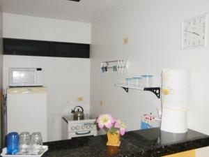 A cozinha ou cozinha compacta de Apartamento Ametista 2 + Bykes