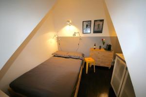 Кровать или кровати в номере Le Petit Studio à Opera