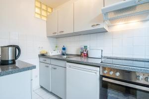 A kitchen or kitchenette at Fair Apartments