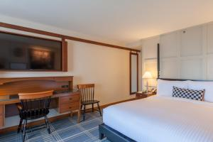 A bed or beds in a room at The Charles Hotel in Harvard Square