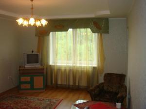 A television and/or entertainment center at Apartments at Potemkina 13