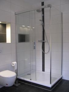 Ein Badezimmer in der Unterkunft Ferienwohnungen am Bernsteinweg
