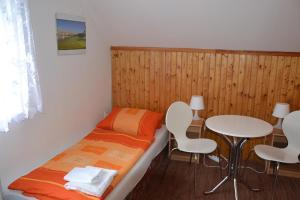 Postel nebo postele na pokoji v ubytování Penzion Panorama